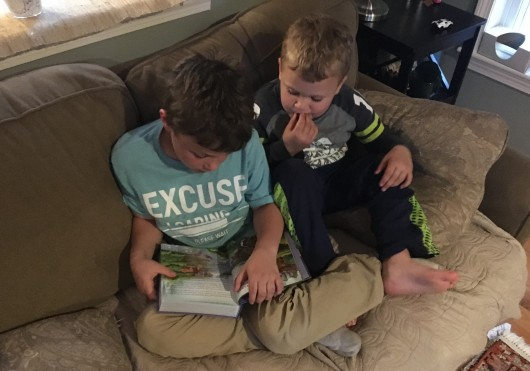 Ty's Godfather, Uncle Mike, couldn't be here but was here in spirit. This is a pic of Ty reading the children's bible he got him