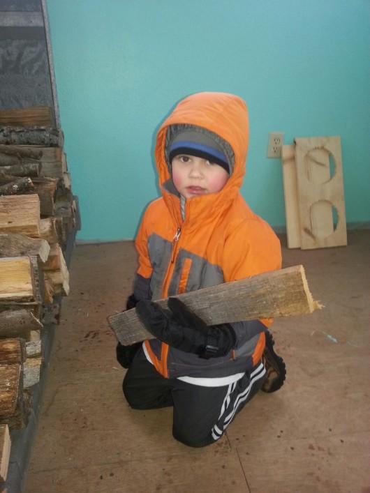 Stacking wood at Aunt Ashleys